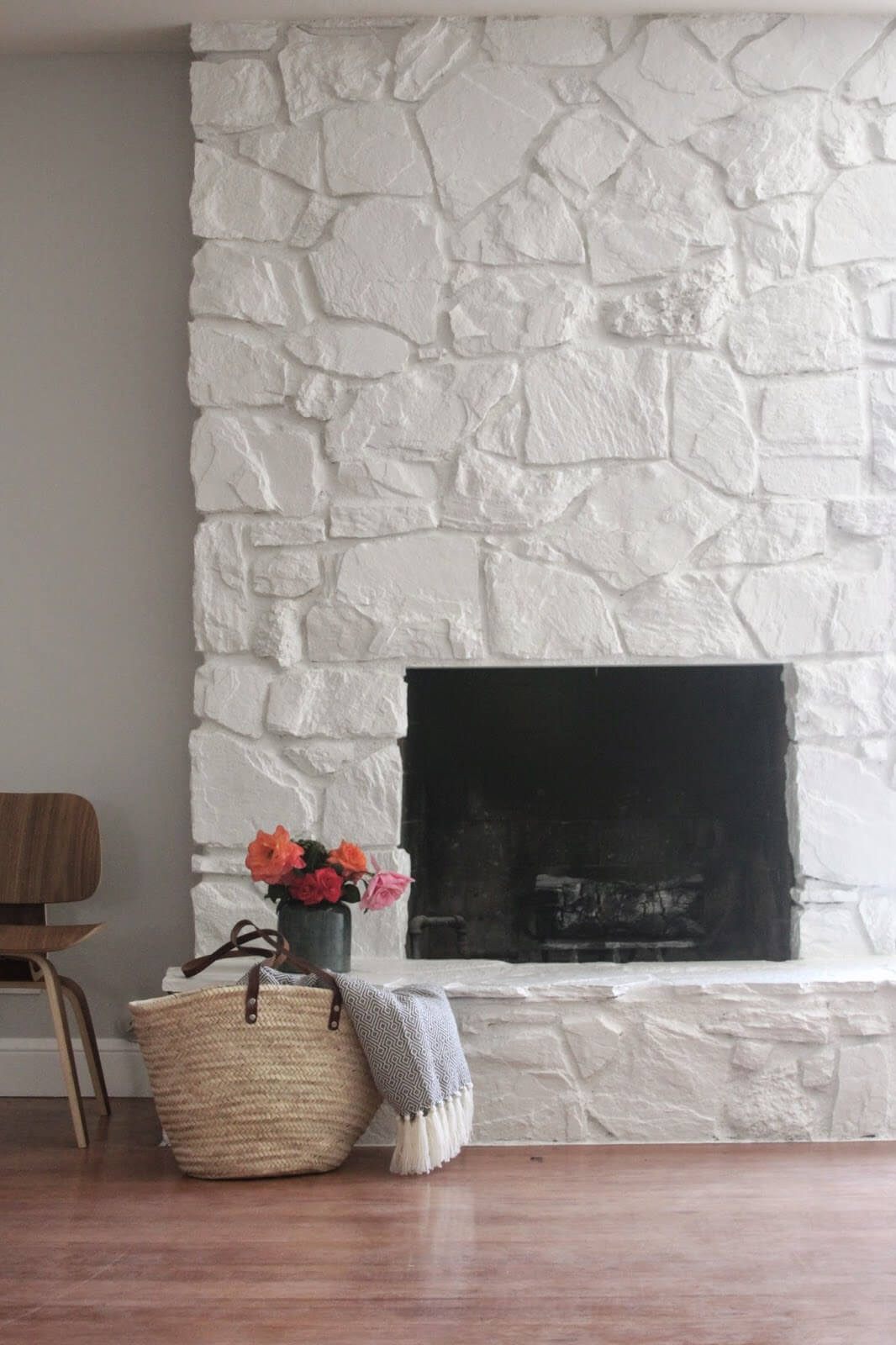 Painted Stone Creates Simple White Fireplace