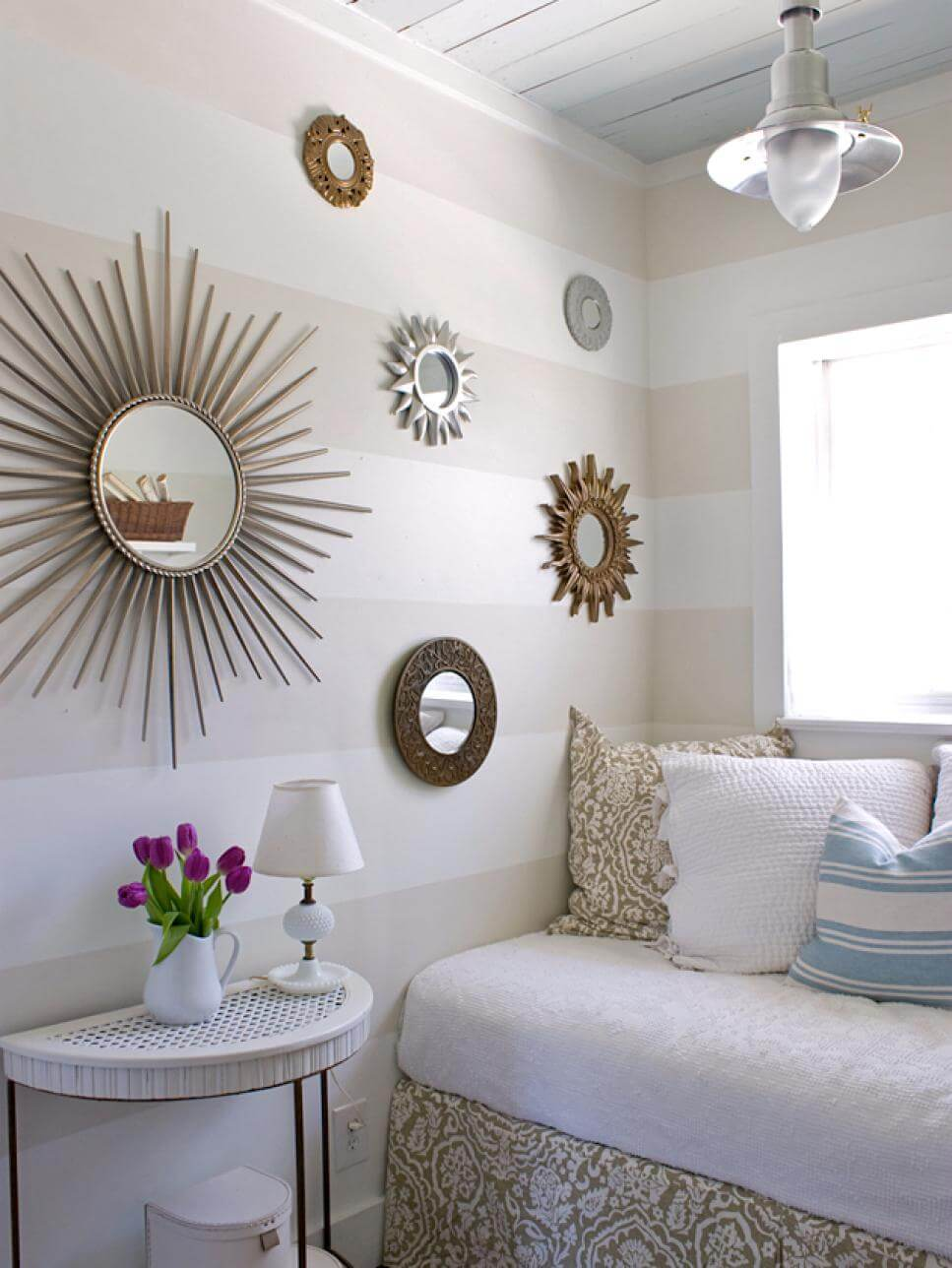 Mirrors of Suns and Circles on Striped Wall