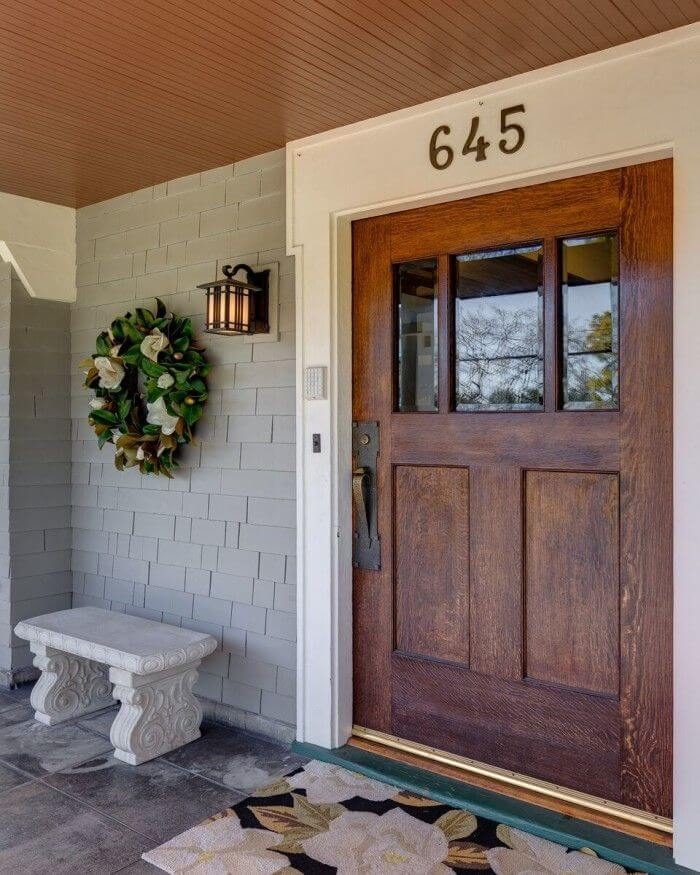 Big Door For A Big Home With Wall Lamps