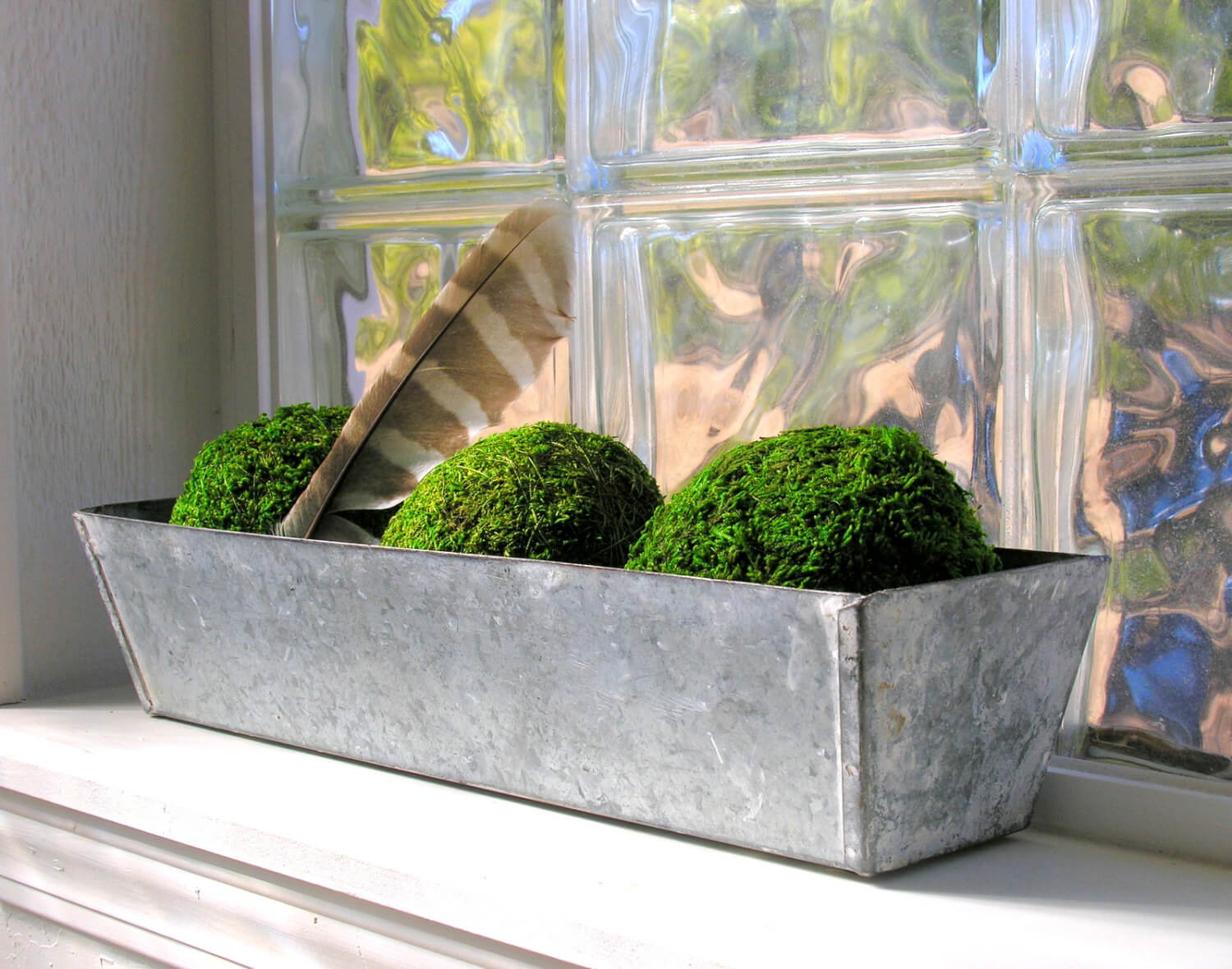 Topiary Balls in a Long Metal Holder with Feather