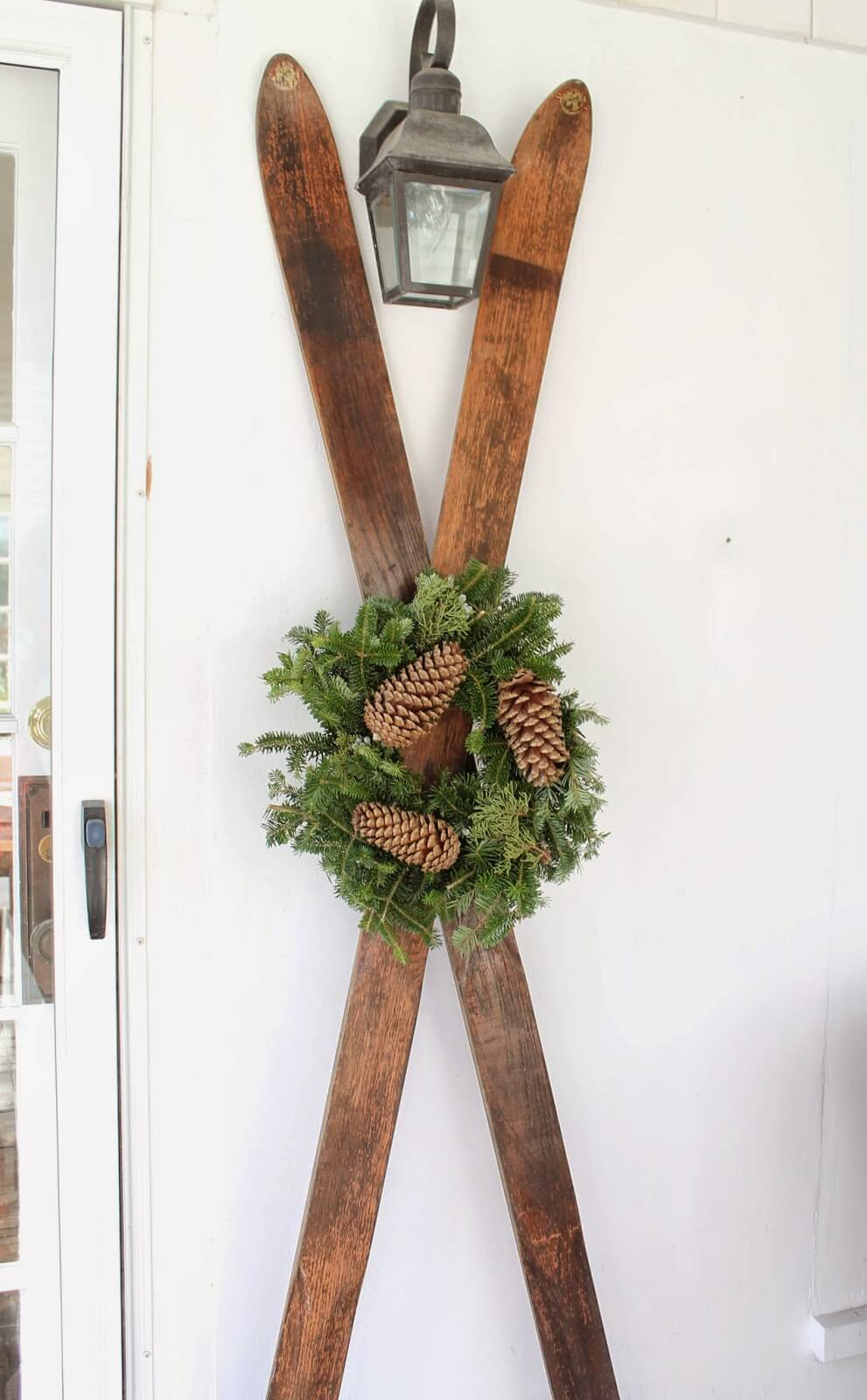 Antique Skis With Pine Wreath Display