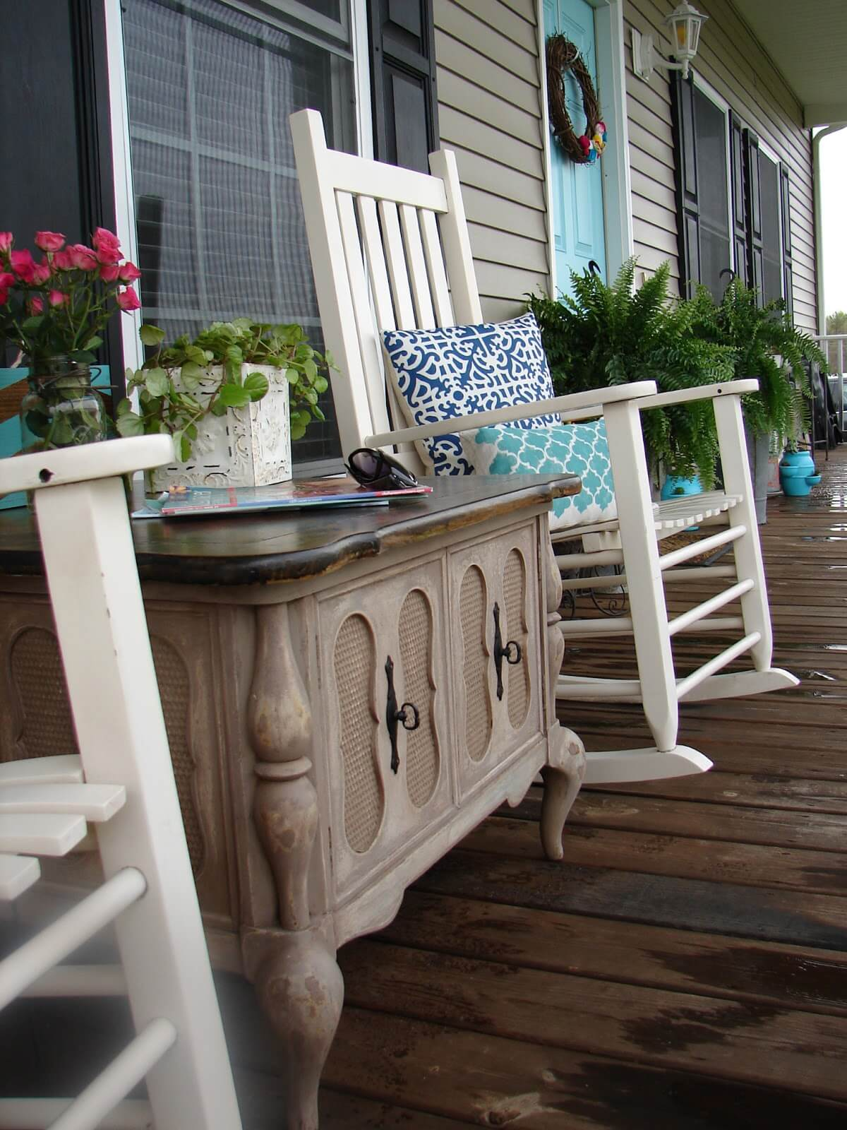 Wooden Table, Rocking Chairs, and Patterned Pillows