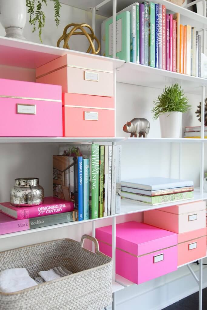 Color Coordinated Storage Boxes On A Bookshelf