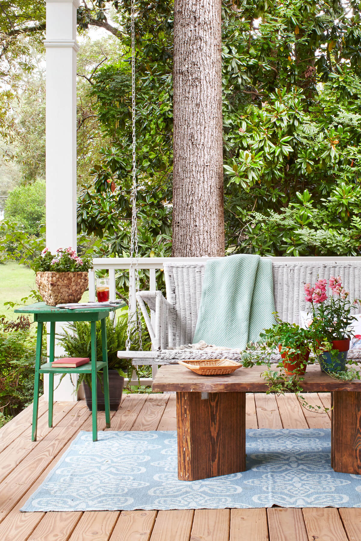 Outdoor Living Room With Wicker Porch Swing