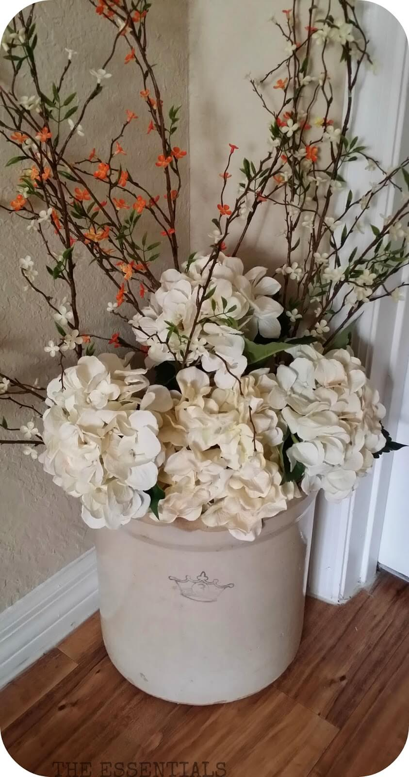 Arranging Flowers in Stoneware Crocks