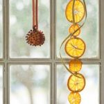 hang-aromatic-orange-garlands-in-a-window-where-the-light-can-also-shine-through