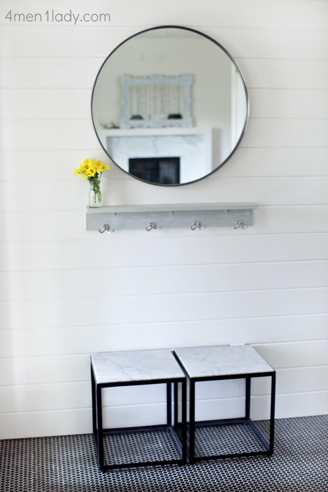 Marble and Tile Cosmopolitan Foyer with Mirror